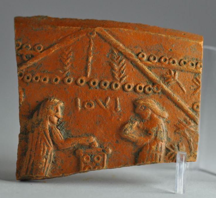 Roman vase, roman terracotta vase, Samian ware shard with two figures making offering on altar to god Jupiter, 2nd-3rd century A.D. Roman vase, roman terracotta vase, Samian ware shard with two figures making offering on altar to god Jupiter inscribed IOVI, 5 cm high. Private collection