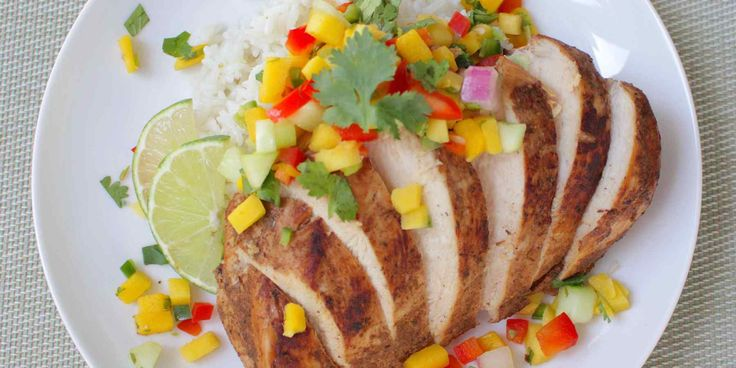This Jerk Chicken with Tropical Salsa will spice up your night! Typically jerk seasoning is spiced with Scotch Bonnet chili peppers (or Habañeros) an