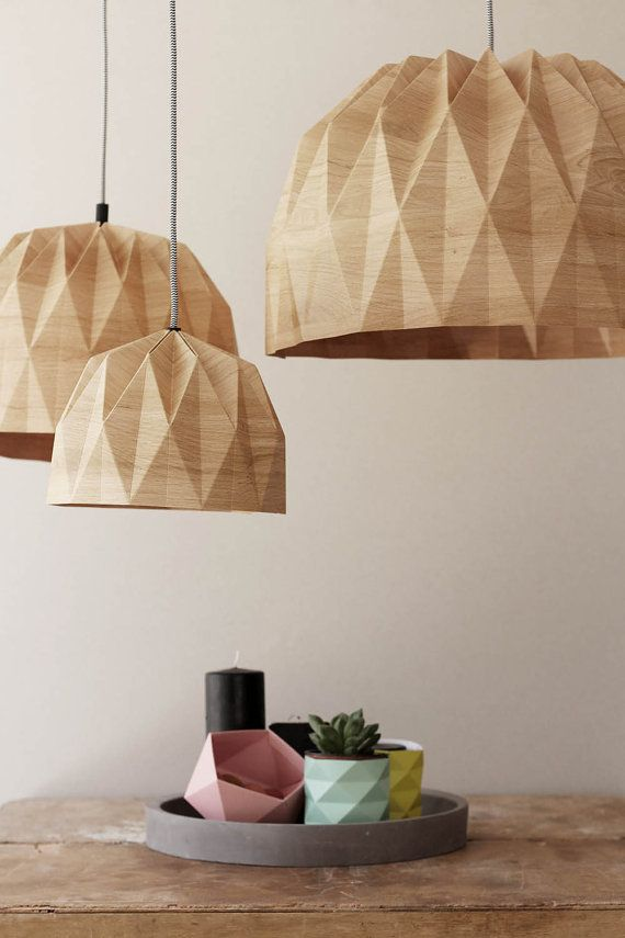 A beautiful origami pendent lampshade. The lampshade is made of paper with a wood print on it. The cord is Black and White and its 43 inches | 1.1 m long. If you wish to get the cord in another color please convo us about it. If you wish to receive the lamp with a wall plug instead of the ceiling rose please convo us. Lampshade dimensions: Diameter: 19.7 inches | 50 cm Hight: 11.8 inches | 30 cm  Please use a led bulb only. Made of high quality and thick paper covered with two sided…