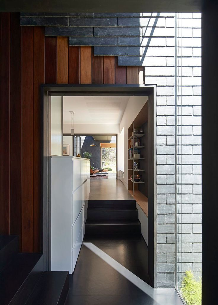 dark grey slate creatively covers this australian home - Slate House Design