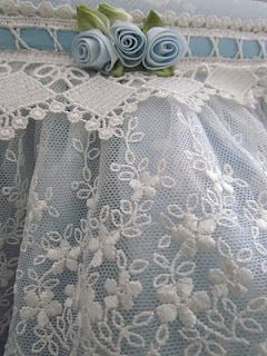 Pretty touches of blue with lace would make a lovely bridal garter...gotta get crackin' on this for daughter's wedding.