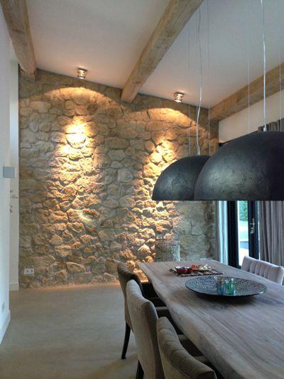Modern dining room with beautiful stone wall. #interior #diningroom #inspiration