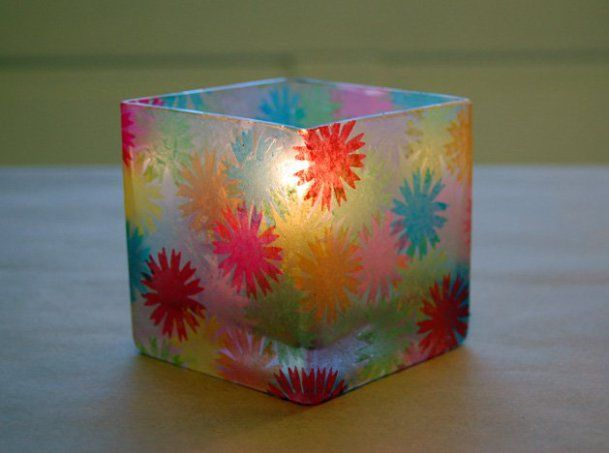 I was inspired by memories of making faux-stained glass in elementary school and came up with these fun little glass votive holders.