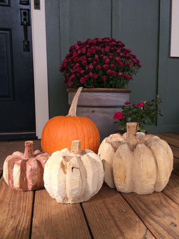 Chainsaw carved pumpkins and pine trees by