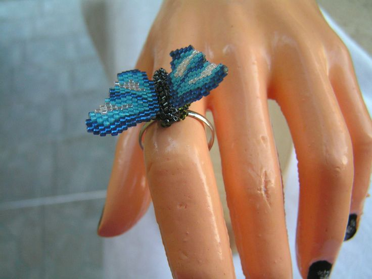 I made 'grass' under the butterfly from green seed beads. Therefore, it seems as if the butterfly had landed just relax the wearer's finger.  The butterfly was made adjustable silver plated ring base. -   Height: 3cm,  Width: 4 cm