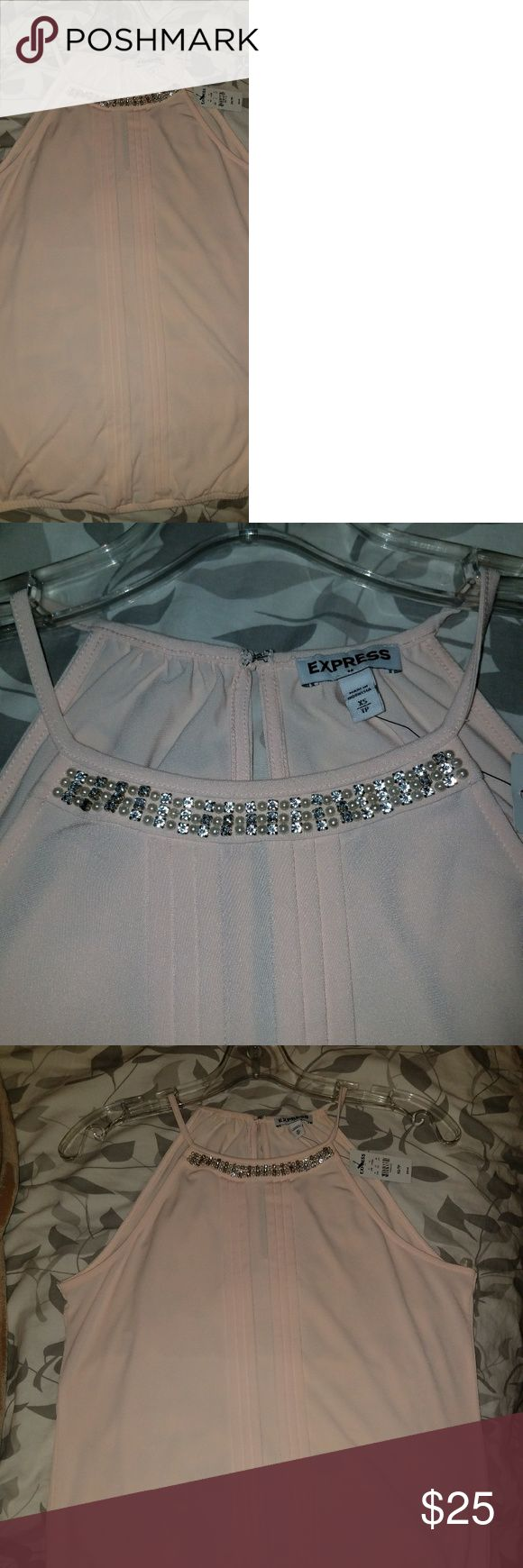Blush (light pink) halter top This is brand new.  Never worn.  Tag is still on it.  Size XS. Purchased from Express Clothing store. Top is jeweled + tiny pearls.  Feel free to contact me if you have any questions. Express Tops