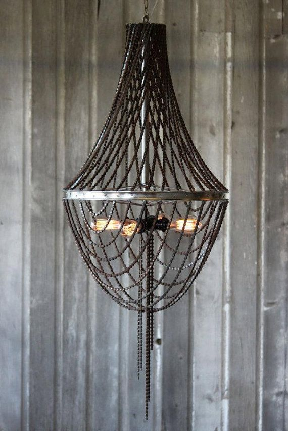 Awesome Bicycle Wheel and Bicycle Chain Chandelier. By Upcycle bicycle, via Etsy.