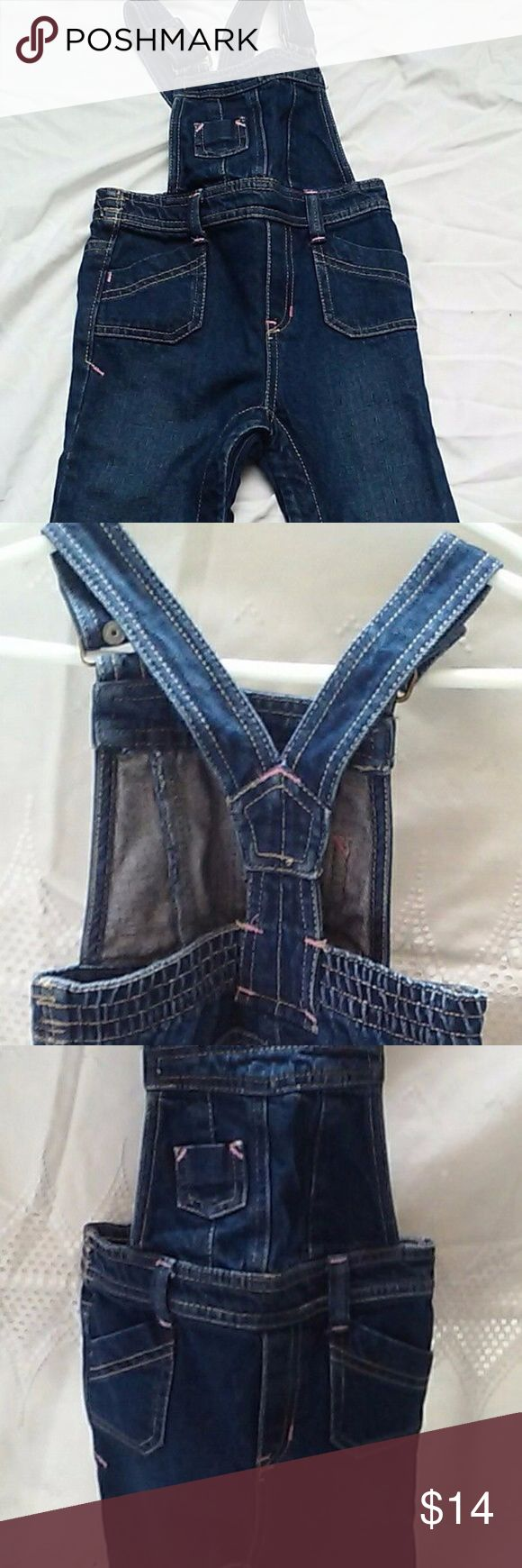 "Old navy Dark Denim Jeans Overalls NEW 18-24mo Up for grabs is a mint condition, new, never worn (no tags) dark denim Old navy coveralls with pink and beige stitching, size 18-24 mo. length from top of shoulder to bottom of pants: 26 1/2"".  Smoke-free pet-free home. Old Navy Bottoms Overalls"