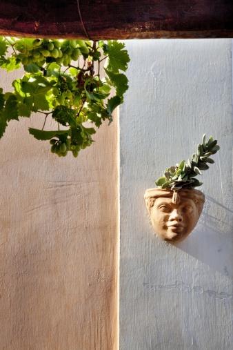 Stock-Fotografie: Sculpture on wall Hotel Signum Malfa Salina Island Aeolian…