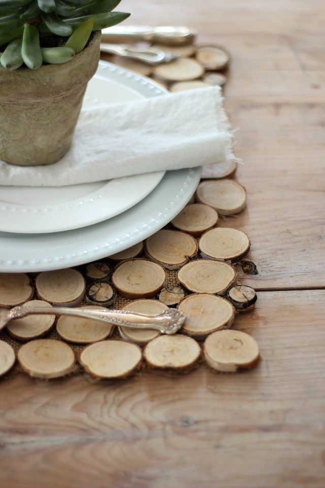 For an easy and inexpensive way to admire nature's bounty, mix and match different sizes of wood chips to make these rustic placemats.  Get the tutorial at Craftberry Bush.    - CountryLiving.com