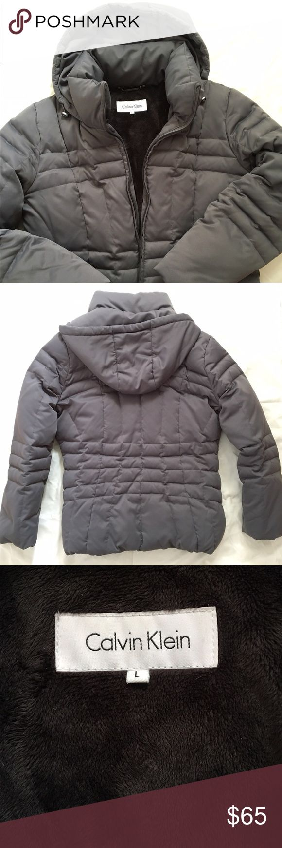 Women's Calvin Klein Puffer Coat Women's Calvin Klein down insulated puffer coat, hooded with a snuggly soft liner and interior pockets as shown in photos.  Grey, size large. Calvin Klein Jackets & Coats Puffers