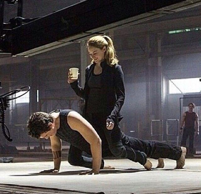 Miles Teller doing push ups while Shailene sits on him.