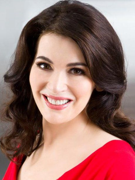 Nigella showcases how a Deep colouring should dress. Strong Bold scarlet will work wonders