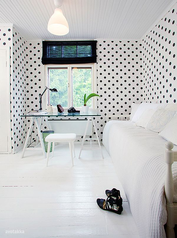 Black polka dots on white wall in Nordic style home office