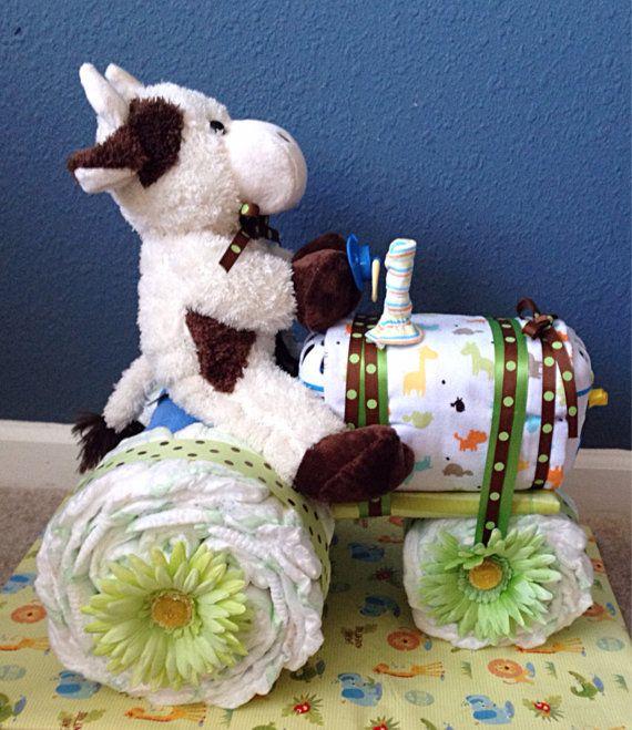 Parfait cadeau ou bébé Centre de douche ! Absolument merveilleux pour une famille de paysans ! Surtout un éleveur de bétail. Il est livré entièrement un emballage cadeau et comprend :  • 28 couches • 3 débarbouillettes de bébé • 1 attache tétine panier de lave-vaisselle • 1 bébé ustensile • 2 couvertures • 1 paire de chaussettes • 1 bourré pour pilote