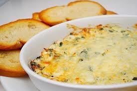 Jalapeno Artichoke Dip  1 8oz pkg cream cheese, softened,  4oz sour cream,  1 can artichoke hearts, drained, chopped,  3oz chopped jalapenos,  3 tbsp jalapeno juice,   1 cup shredded parmesan cheese,  1/2 cup shredded cheese.
