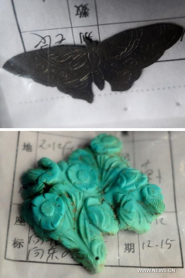 Combination photo taken on June 22, 2013 shows a silver butterfly (upper) and a calaite ornament found at the archeological site