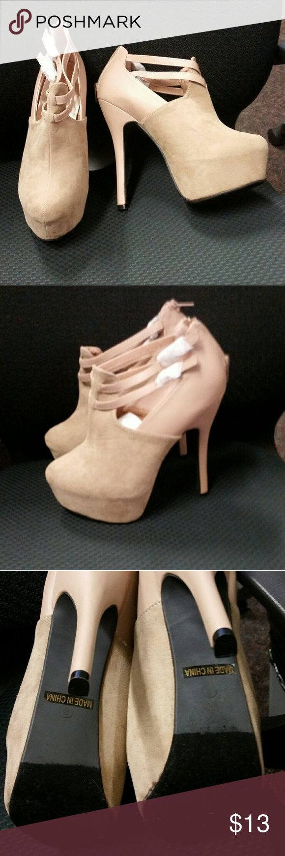 Nude ankle platform boot Nude ankle platform ankle boot new never worn has a little dirt on tip of one shoe see pic. Too high for me too late to return. Make me an offer. red circle Shoes Ankle Boots & Booties