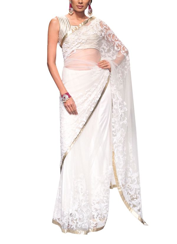 A classic ivory net saree by Siddartha Tytler that lets you exude a look of understated elegance. The saree with delicate floral motifs features a sequin embroidered jaal border. The blouse beautifully complements the saree with its gold and ivory strip work. The cut out on the back enhances its sensual appeal.