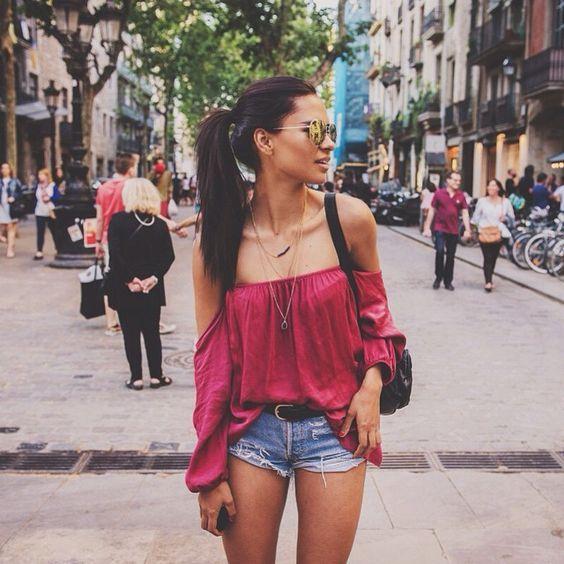 Open shoulder raspberry top, denim jeans. Street style fashion ideas 2016.