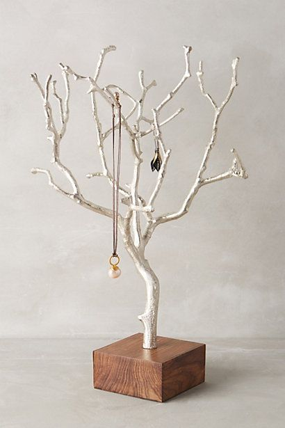 Could make one of these with a branch (paint and sparkles) and a block of wood #anthroregistry