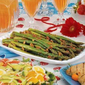 Chilled Marinated Asparagus  In a sauce pan combine the following and bring to boil.  Reduce heat and simmer uncovered for 5 minutes.  Refrigerate until cool.  2/3 cup packed brown sugar  2/3 cup cider vinegar  2/3 cup soy sauce  2/3 cup vegetabel oil  4 tsp lemon juice  1 tsp garlic powder  Meanwhile blanch 2 lb fresh asparagus. chill.Combine marinade and asparagus for 2-24 hours.  Drain and serve.  I add thin strips of red bell pepper to marinade instead of pecans