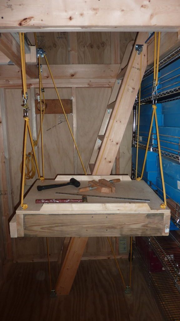 Using pulleys for lift rubbermaid bins into attic.