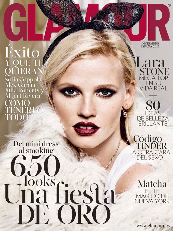 Lara Stone wears a white fur coat and headband with playful bunny ears Pose on Glamour Spain Magazine December 2015 cover shoot