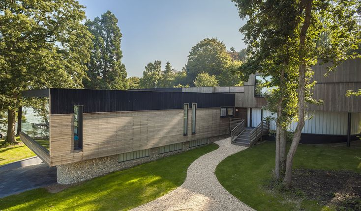 Renovated Isle of Wight Home is clad in beautiful maintenance-free Kebony softwood