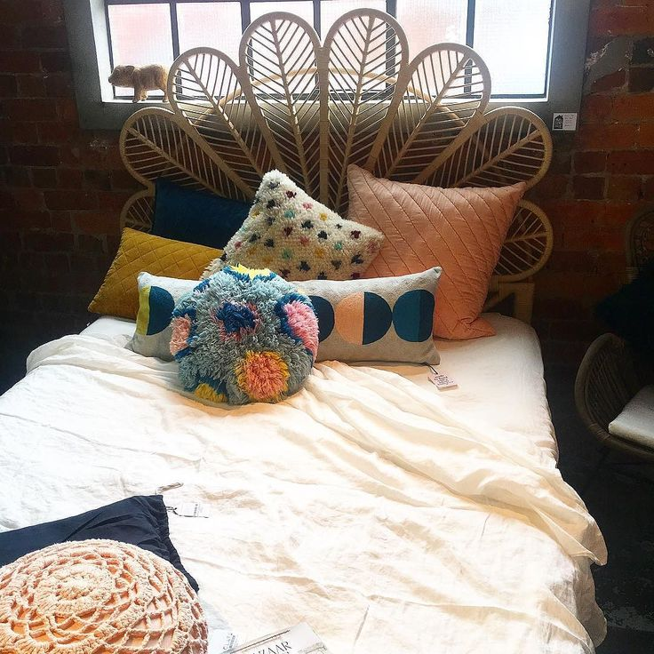 Wish I was in here on this stormy morning! Linen sheets from @general_eclectic Gorgeous cushions from @sageandclare and stunning headboard from @thefamilylovetree. Shot taken in our brand new Newmarket store #newstore #newmarket #osbornelane #sageandclare #thefamilylovetree #general_eclectic #cushionlover #rattan #petalbedhead #shutthefrontdoorstore