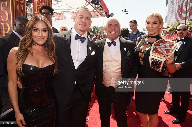 WWE Diva Nikki Bella, host John Cena, WWE wrestler Ric Flair and WWE Diva Charlotte attend the 2016 ESPYS at Microsoft Theater on July 13, 2016 in Los Angeles, California.