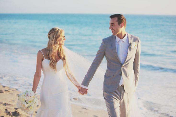 Pure Lavish Events | Coastal wedding | Orange County | Blue wedding | Blue and White | Copro Studios | Bride and Groom on beach |