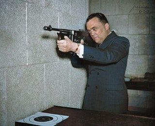 J.Edgar Hoover with a .45 Caliber Thompson Submachine Gun - 1936