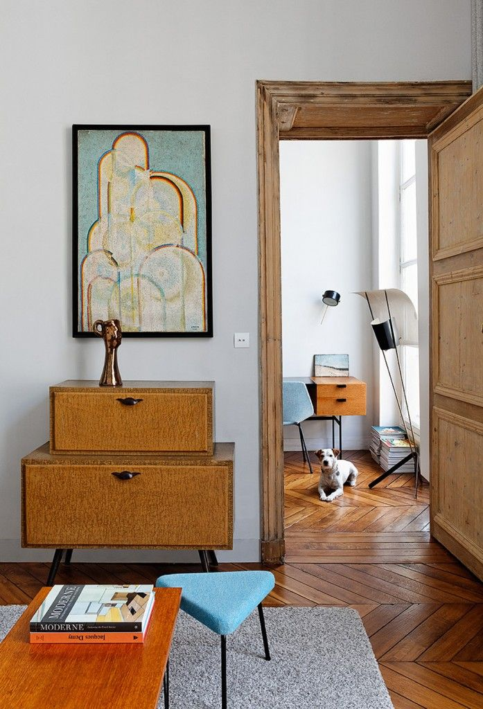 This is the home of young interior designer Charlotte Vauvillier. In her tiny 40m2 Parisian flat, the designer has done a clean and modern renovation, tastefully furnished with some carefully-handpicked mid-century pieces and finely-executed made-to-measure furniture. Materials are kept simple