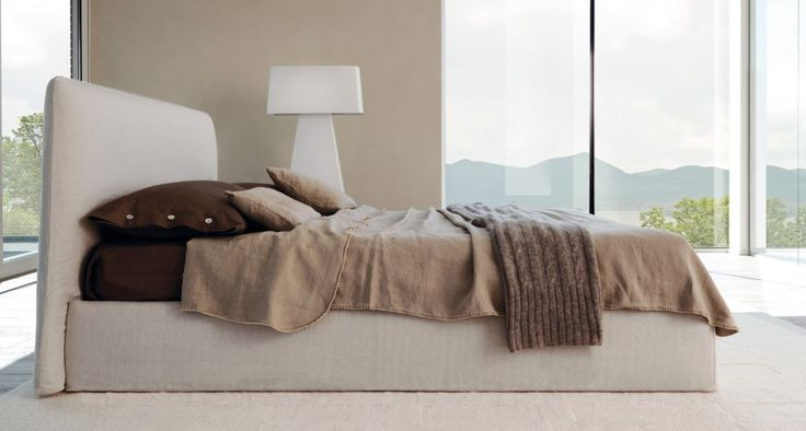 LOV - Lov bed has a characteristic appearance due by lining bag, sewn with a stitch types of thread matching (optional), reminiscent of the art of embroidery. Easy to pull off and wash, is available in fabric or leather.