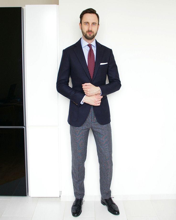 Navy blazer, grey trousers, light blue shirt, burgundy tie