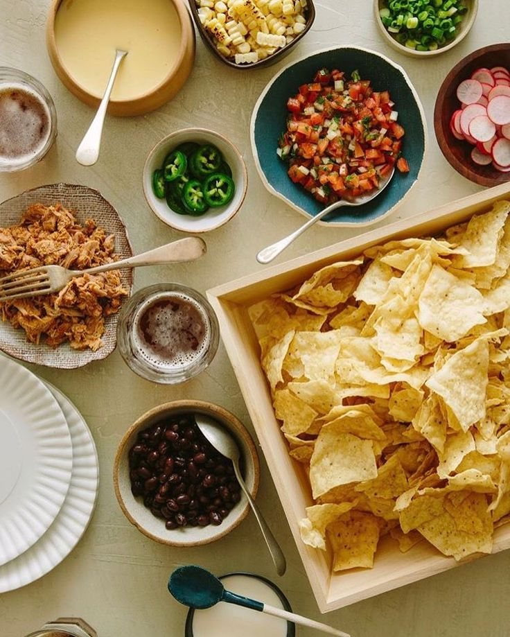 """Happy #cincodemayo everyone! We're celebrating with tons of margaritas and our DIY Nacho Bar...naturally 😊 How are you guys celebrating today?! Find all the details for this Nacho Bar on SpoonForkBacon.com and search for """"nacho bar"""" . . #cincodemayo #foodandwine #nachos #spoonforkbacon #cincodemayoparty"""