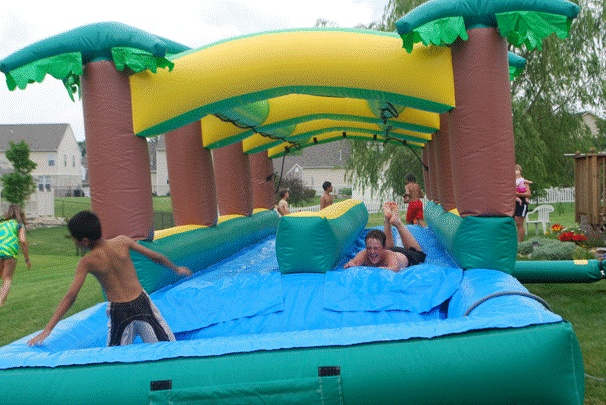 This 40 foot carmel slip n slide has a swimming pool attached at the end your local inflatable for Local swimming pools with slides