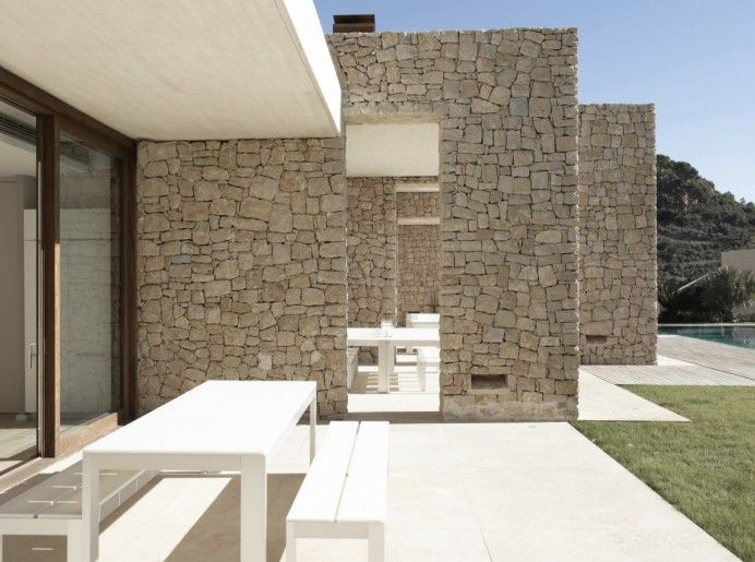 Modern Home in Spain with Stone Façade Design - Architecture Admirers