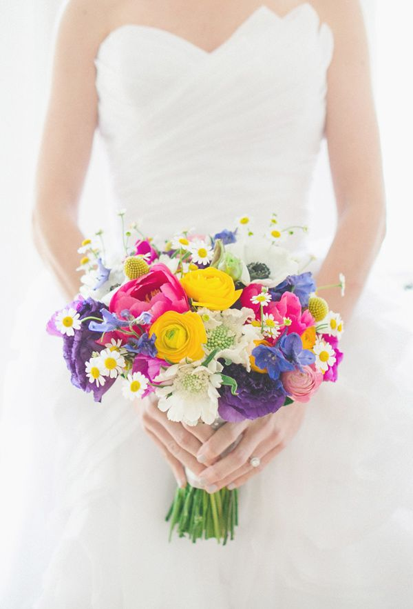 colorful bright bouquet - photo by The Schultzes http://ruffledblog.com/whimsical-and-colorful-wedding-in-savannah #weddingbouquet #flowers #bouquets
