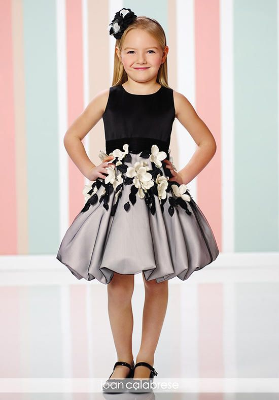 Sleeveless satin and tulle knee-length A-line dress with jewel neckline, satin bodice with ruched tulle waistband, large three-dimensional flowers and leaves adorn gathered tulle overlay bubble skirt.