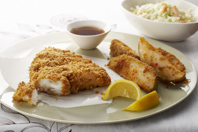 Look no further for an Easy Baked Fish and Chips Recipe! This baked fish and chips recipe yields crispy, flaky baked haddock and tasty potato wedges.