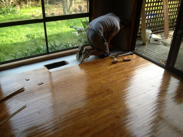 Distressed Timber Flooring planks being installed by our professional layer