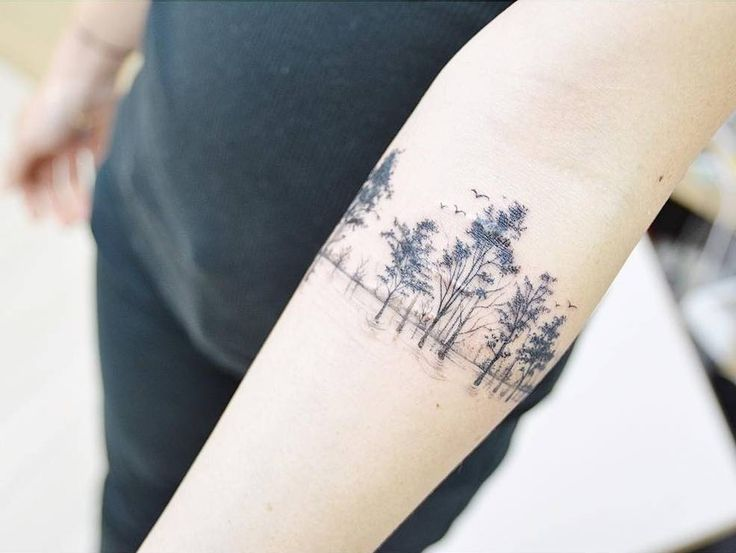 Scar cover tree tattoo on the right inner forearm.