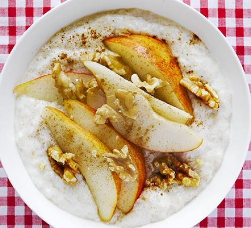Creamy yogurt porridge with pear, walnut & cinnamon topping