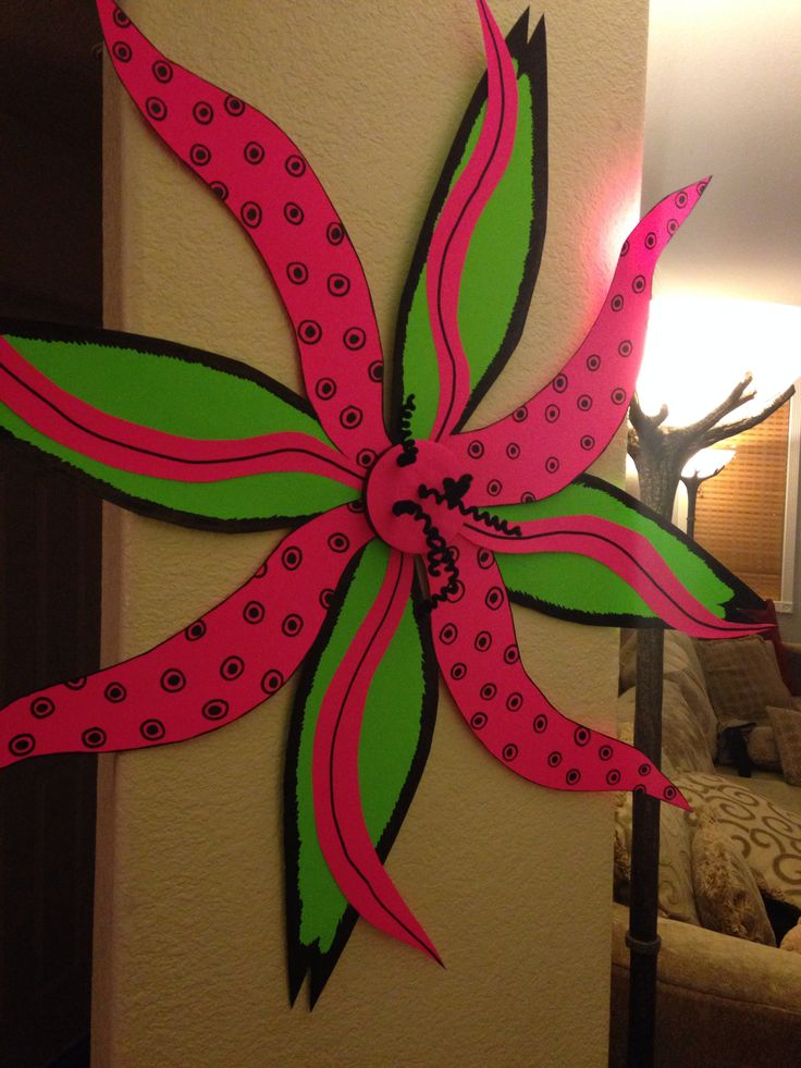 Crazy flower for Weird Animal VBS  - Neon Poster board ($ store) - Giant Sharpie ($ store) - Styrofoam disk ($ store) - Straws to support leaves from back - Pipe-cleaners  - Hot glue to adhere styrofoam disk to front - Tape to adhere straws to paper  paper to        paper - String / market twisty for hook on back  1) free hand draw the flower petals        decorate with sharpie 2) arrange petals as desired  tape in place 3) glue disk  stab in pipe cleaners 4) attach hook to back