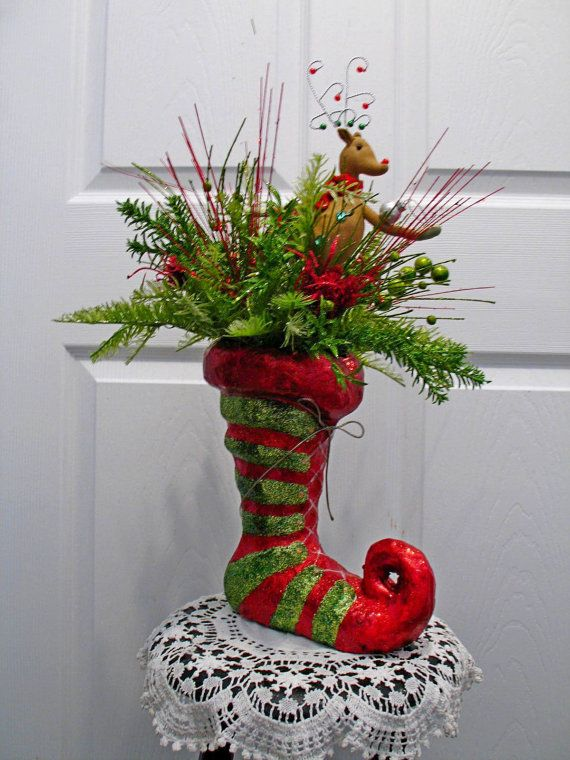 Whimsical elf boot floral arrangement reindeer decor