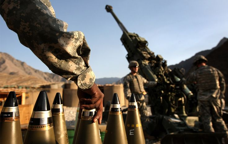 Artillerymen await coordinates before firing a 155mm Howitzer on a Taliban position October 22, 2008 from Camp Blessing in the Kunar Province of eastern Afghanistan. Their unit, Charlie Battery, 3rd Battalion of the 321 Field Artillery, has fired more than 5,900 shells since they deployed to Afghanistan less than a year ago, making it the busiest artillery unit in the U.S. Army, according to to military officers.
