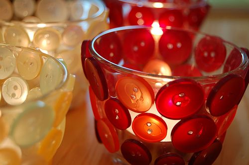Candle holders with buttons
