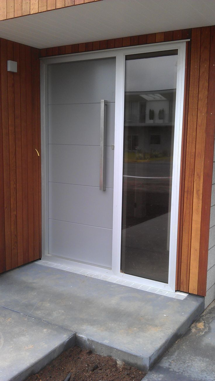 Ad some style with a timber trim around aluminium door